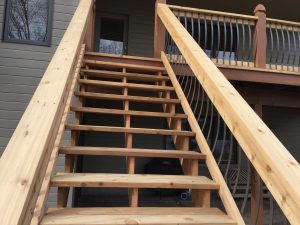 Cedar deck with metal railing pieces